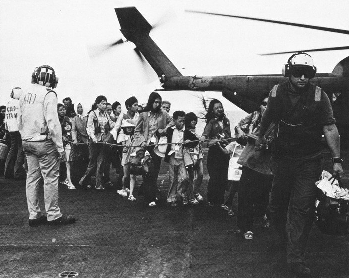 The lucky ones who made it from the embassy to the USS Midway. Photo via Wikimeida and the U.S. Navy.