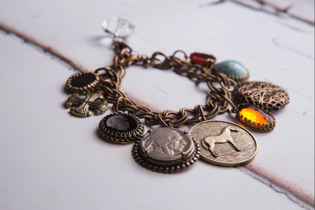 coin charm bracelet.png