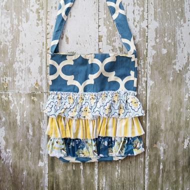 BLUE ILLUSIVE RUFFLE BAG $56