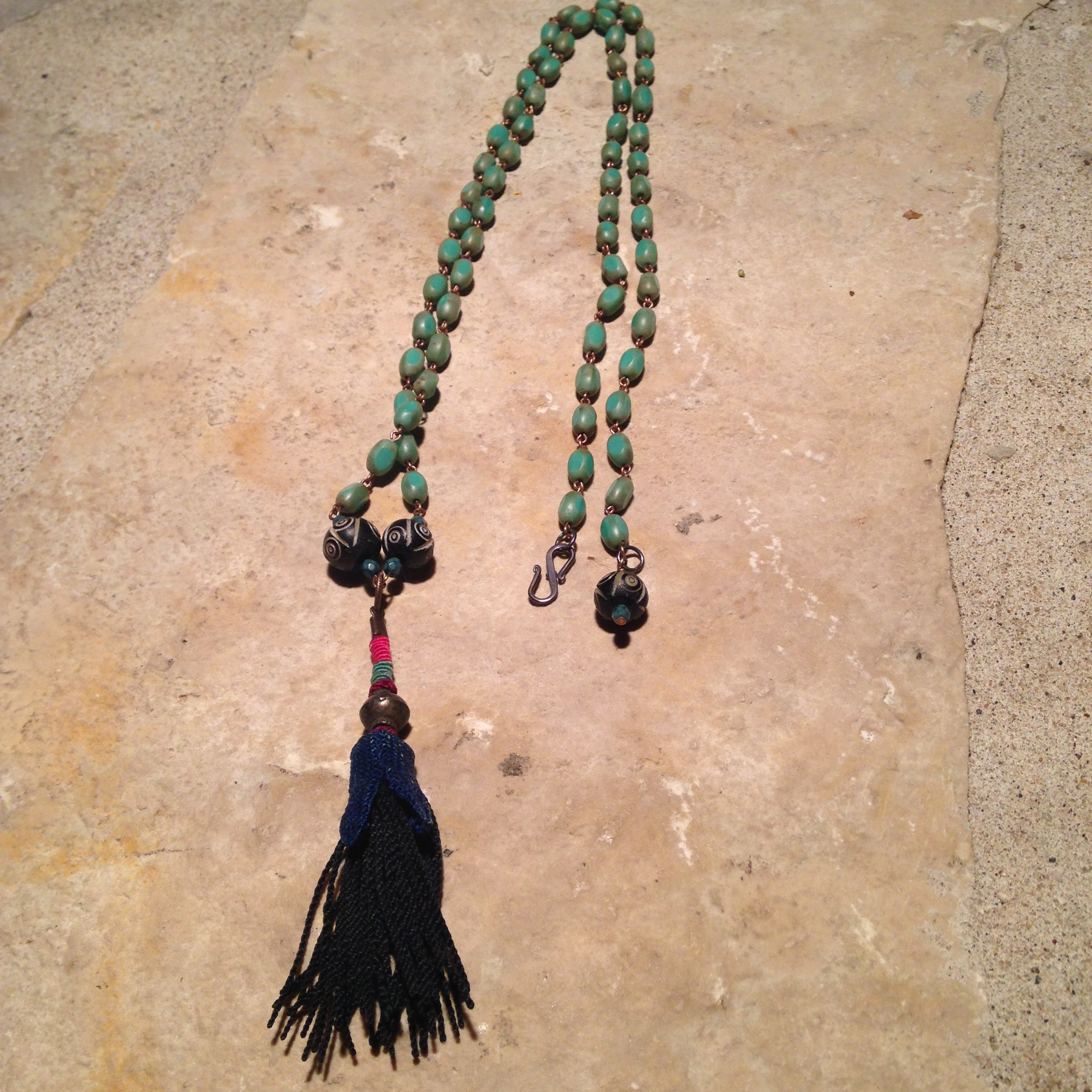 LONG BLUE TASSEL Necklace $156  Popular tassel design with fibers from Uzbakistan and glass beads from the Czech and carved beads from India.