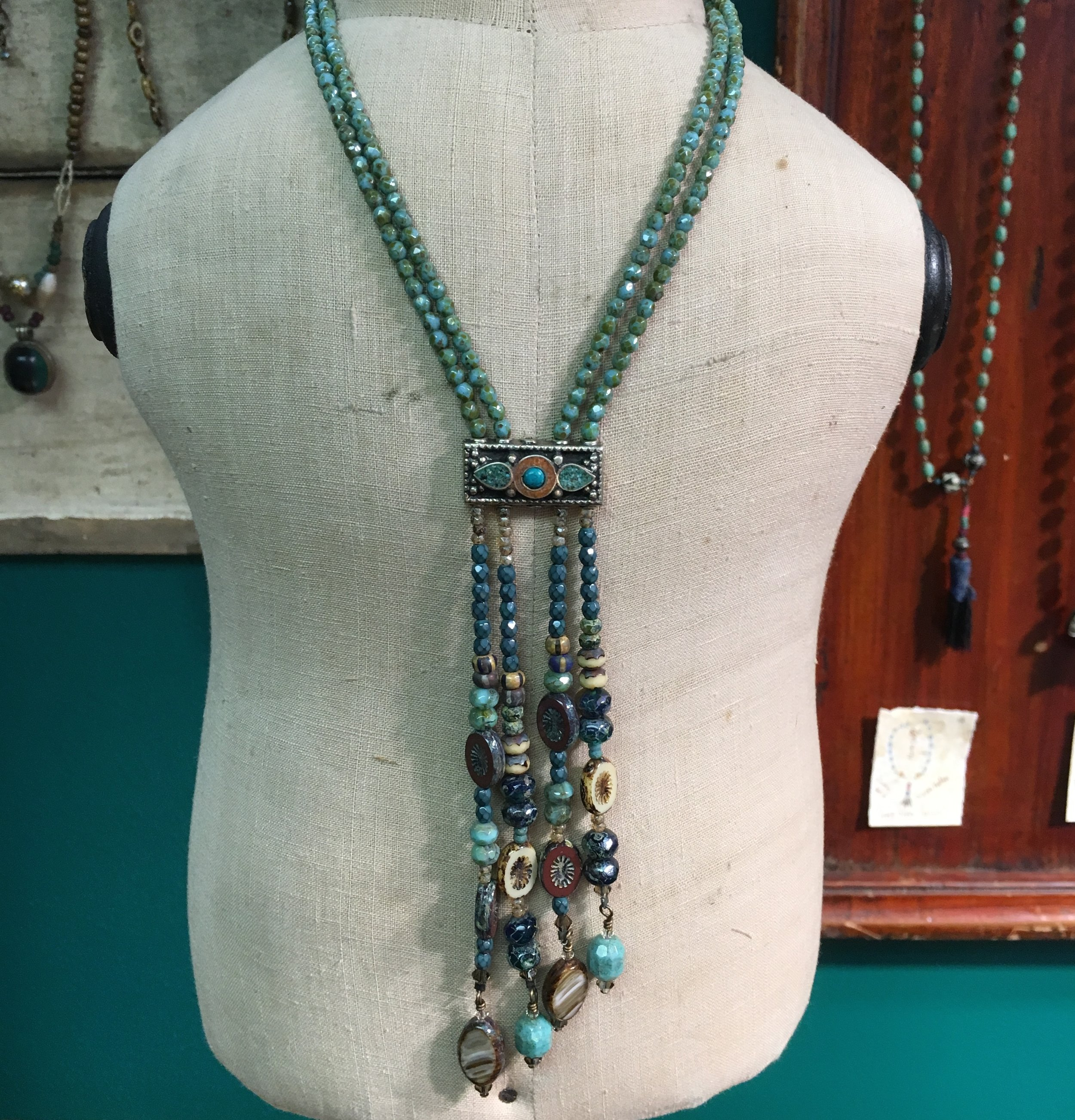 This striking lariat showcases a variety of gemstone Czech beads centered with a gemstone bar from Nepal.
