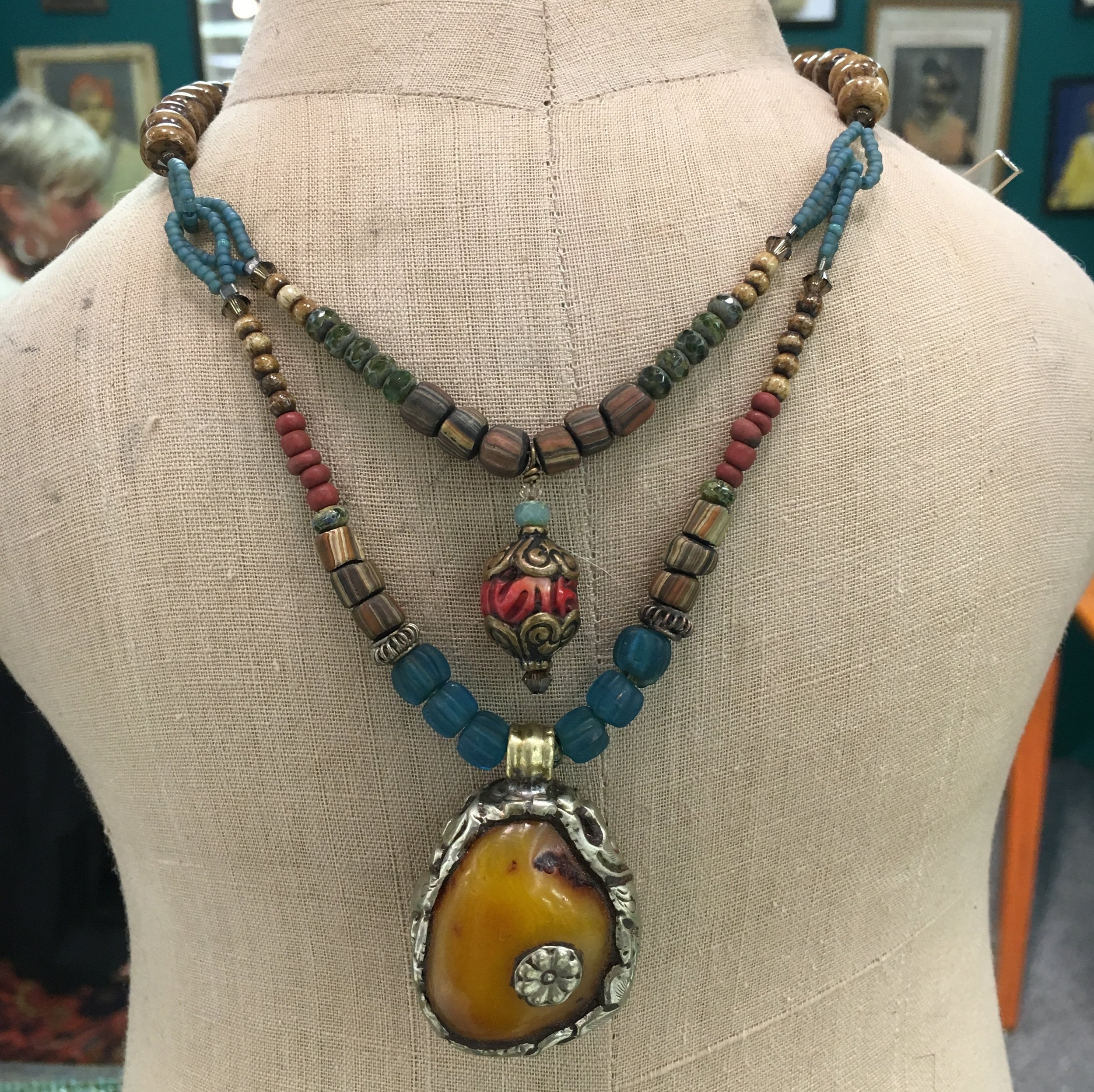 A natural stone from Nepal exquisitely framed and combined with beads from Indonesia, Ghana, Nepal and the Czech