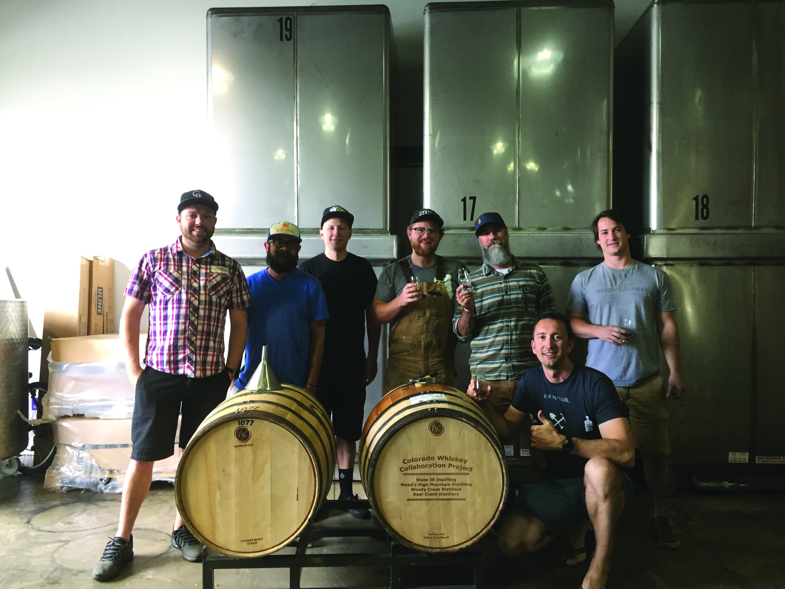 From left standing, Woody Creek Distiller's lead distiller Sean Simpson, Bear Creek Distillery owners Jay Johnson and Jeffrey Dickinson, State 38 Distilling's Joel Randall, Wood's High Mountain Distillery owner P.T. Woods and Woody Creek distiller Blaine Hudson. Front, State 38 Distilling owner Sean Smiley. Photo courtesy State 38 Distilling