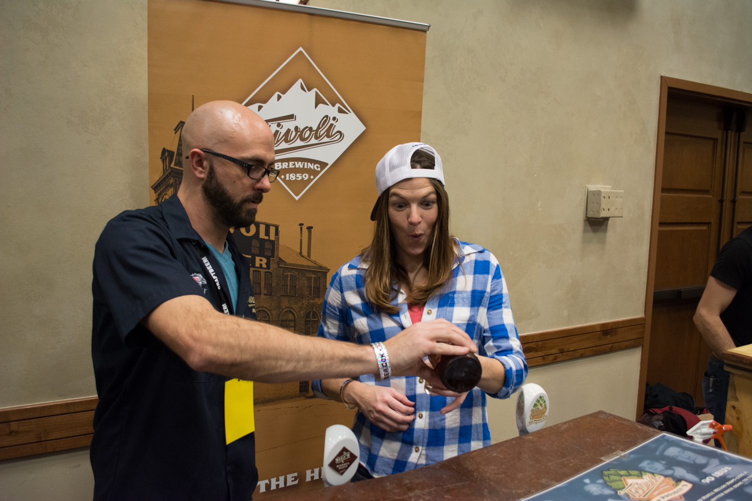 Nate Nicklas from Tivoli Brewing pours one of their new barrel aged offerings.
