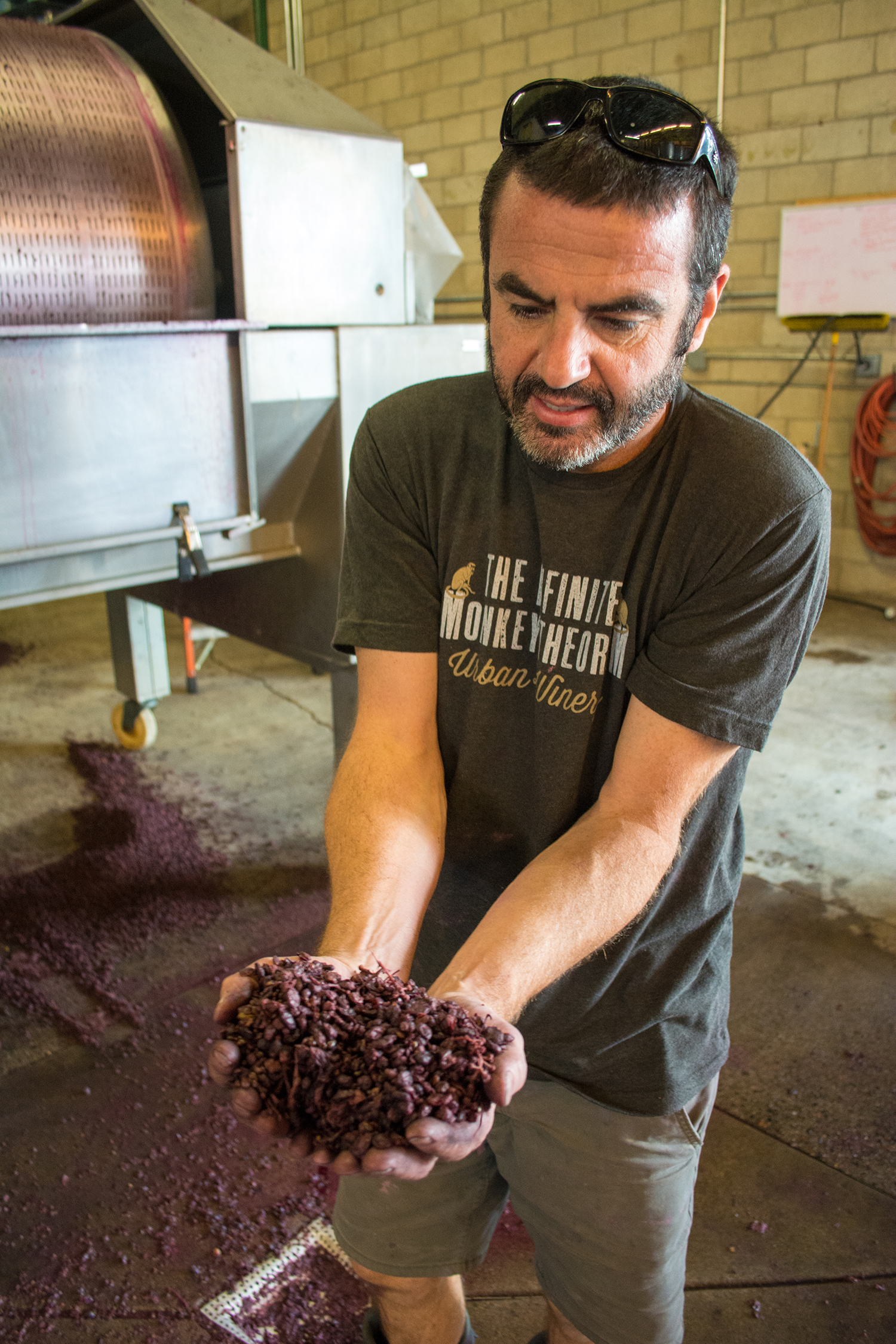 Parsons presents freshly pressed grape skins inside the winery.
