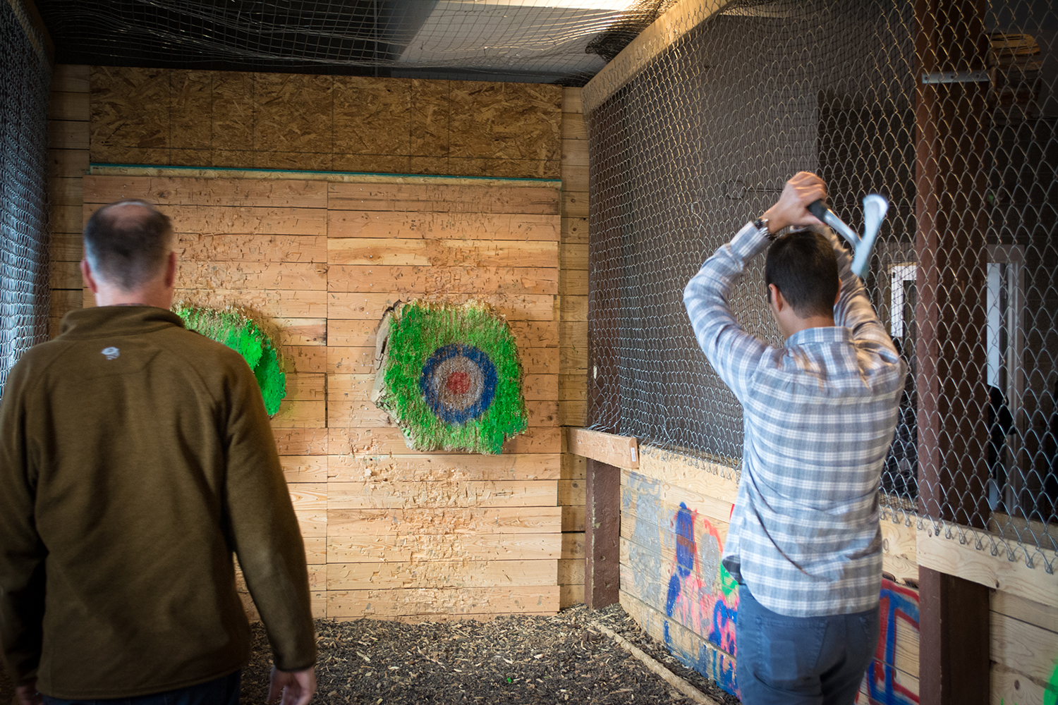 Participants try their hand at hitting the wooden bulls-eye with spinning axes. Photos: Neill Pieper