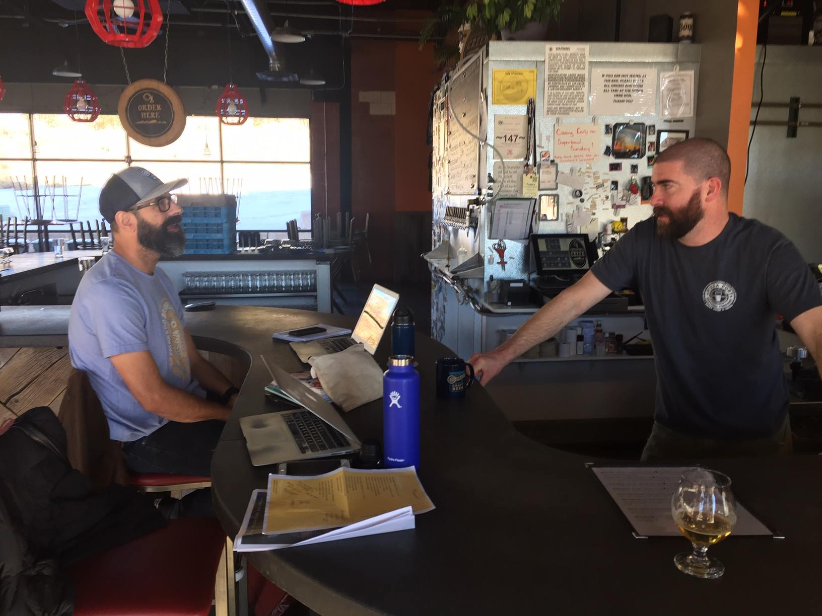 Steve Kurowski, former marketing director for the Colorado Brewers Guild, talks with Cannonball Creek brewer Jonathan Lee.