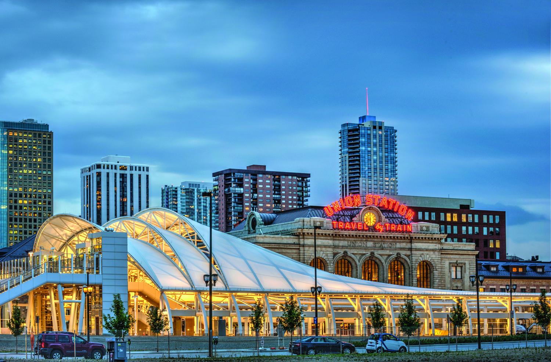 Denver Union Station lights up as the sun sets over Denver. Photo: Courtesy Union Station and Ellen Jaskol
