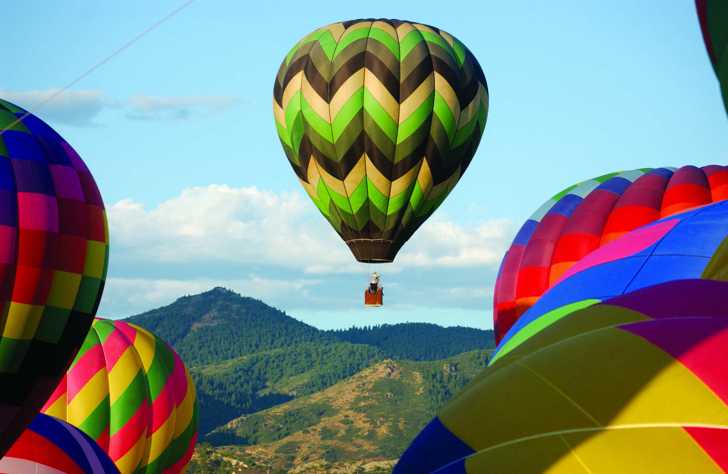 Balloons take flight at Chatfield State Park. Photo: Tom Cooper