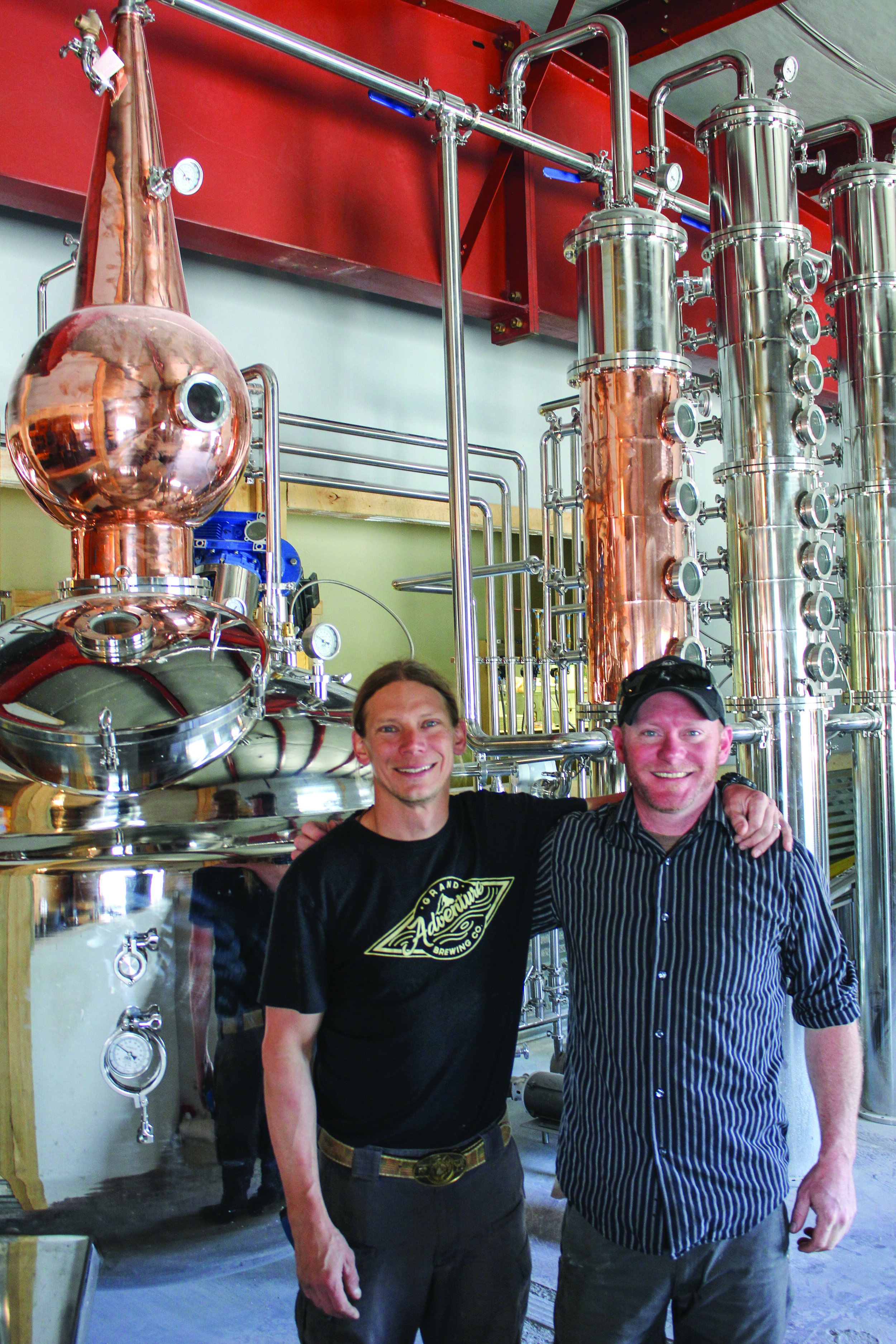 Grand Adventure Brewing Co. founder and brewer Rick Reliford, left, poses with The Dean West restaurant's Jon Harvey. They have combined efforts with distiller Red Waldron to provide craft brew, food and spirits under one roof in Kremmling.