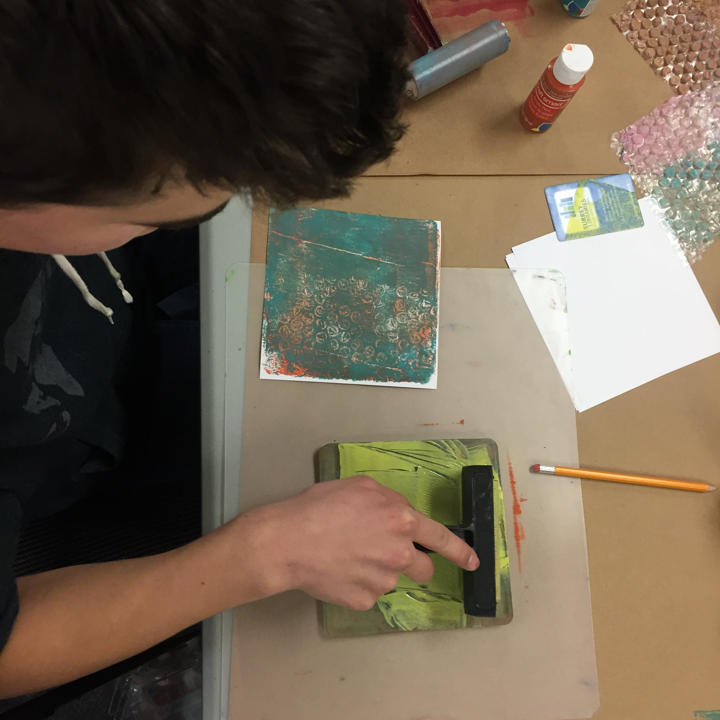My son working on a print.