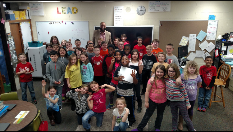 Author and Publisher  Kellen Brandon  spends some time reading KT & The Radical Roundball with students at Dieck elementary in Swartz Creek, Michigan.