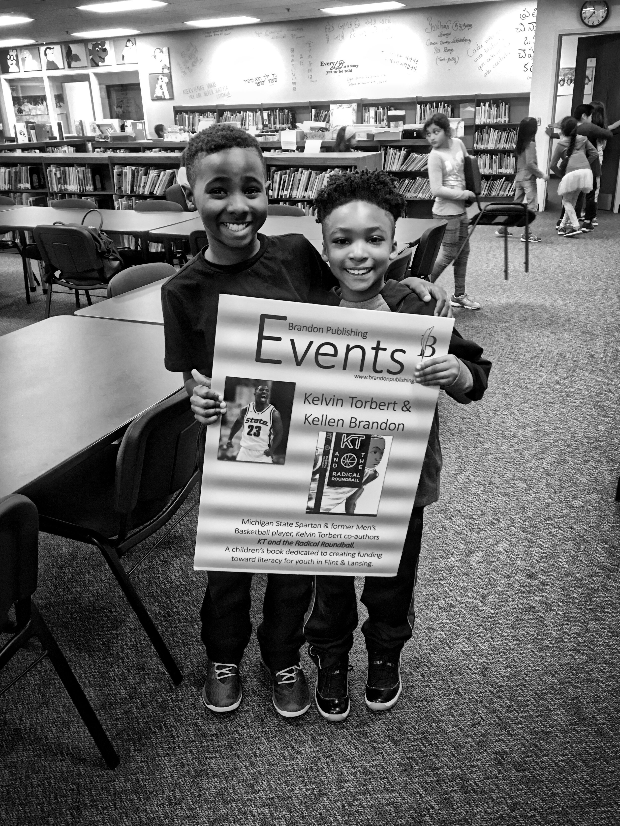Two students from Hiawatha elementary school in Okemos, Michigan celebrate their reading moment with Author's  Kellen Brandon  and Kelvin Torbert. Students really loved the book KT & The Radical Roundball.