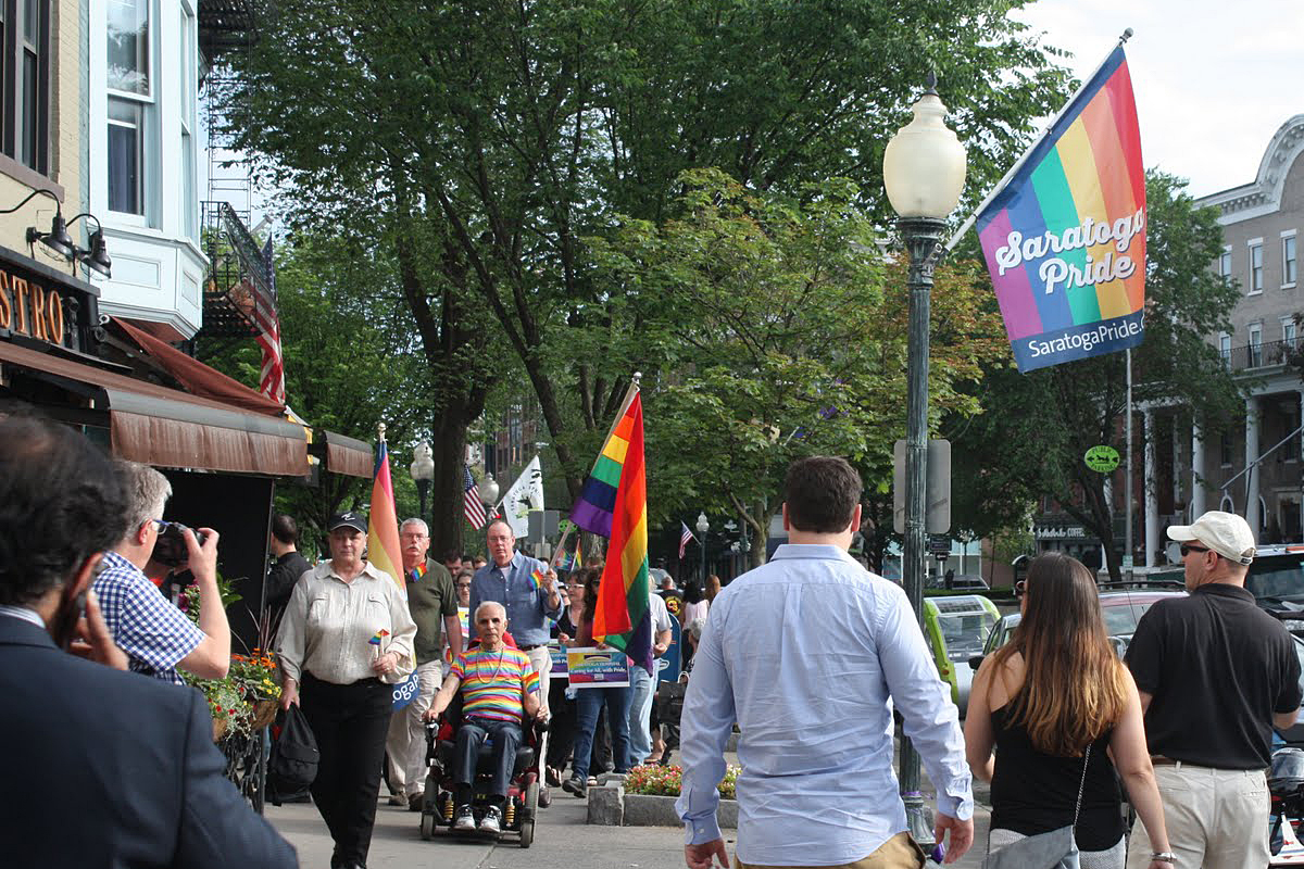 Making our way up Broadway (under one of our street flags!)