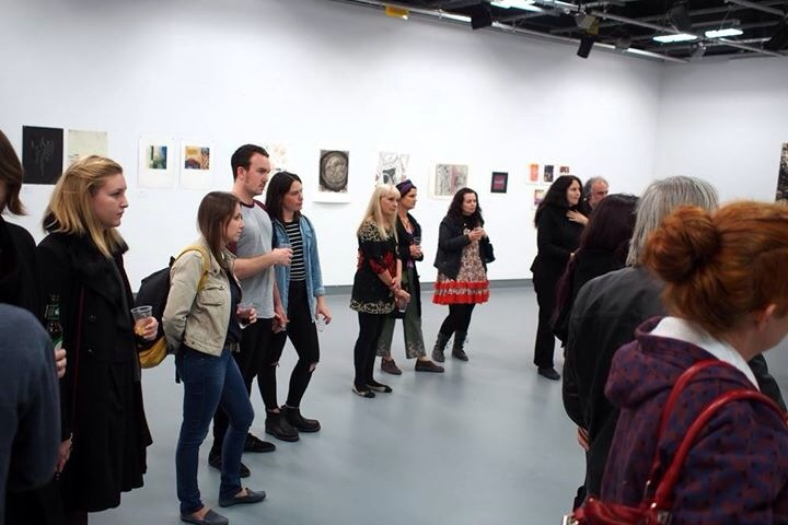 View of exhibition during an artist talk  (photo by Jonathan Tse)