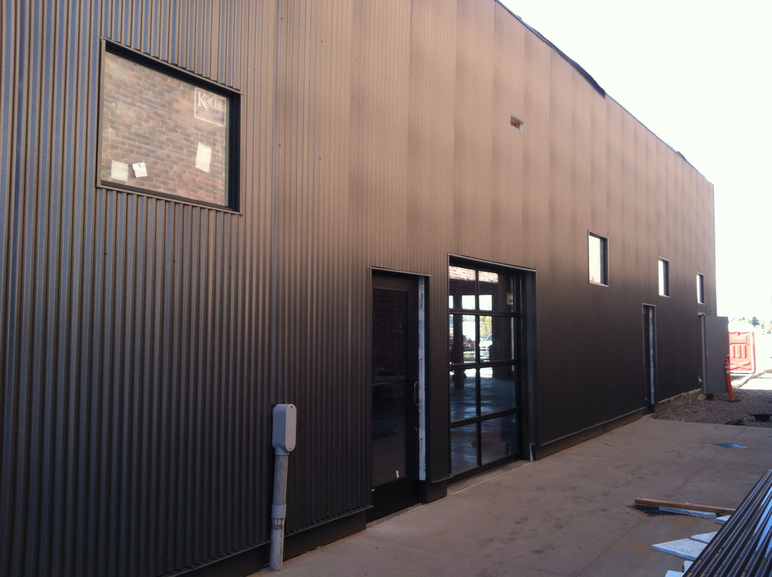 North wall siding, windows and bitchin glass doors installed!!