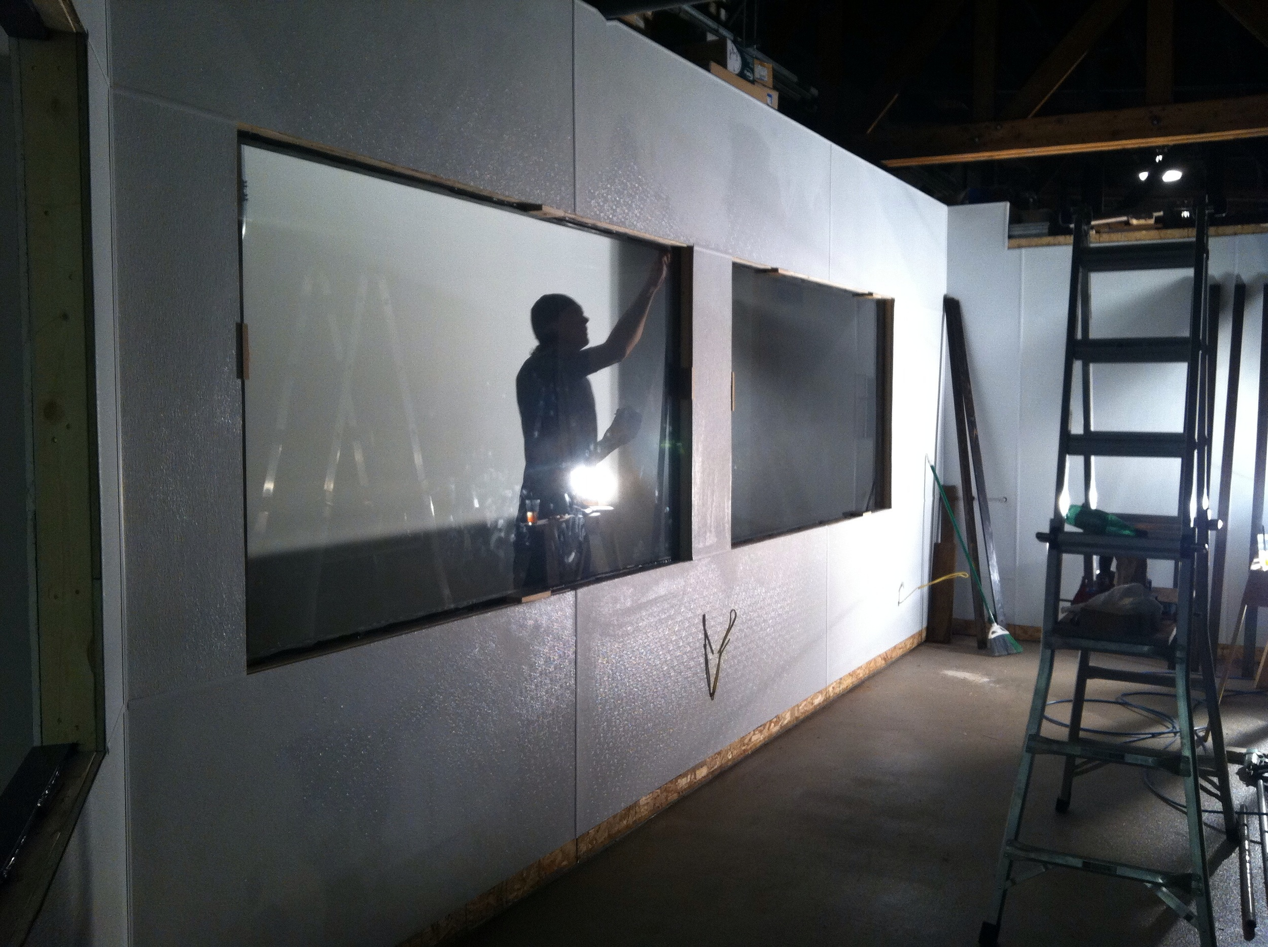 Installing windows in south side production area wall