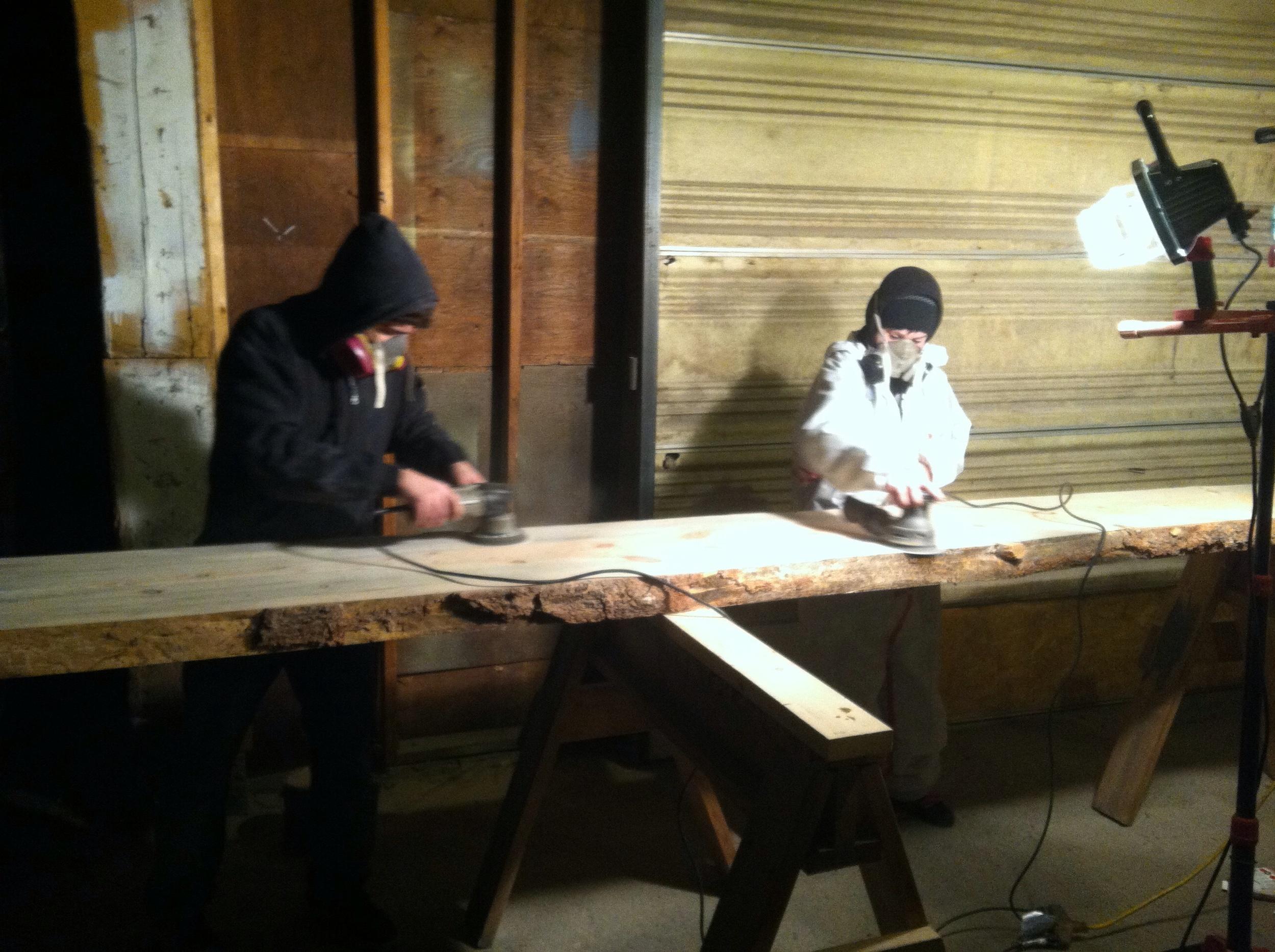 Issac Reiner and Aubrey Swanson sanding the bar down