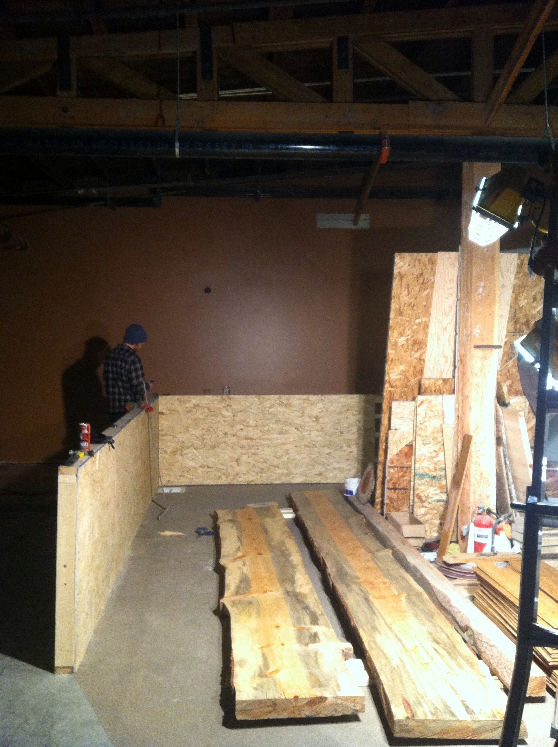 Oriented Strand Board (OSB) installed on backside of bar wall
