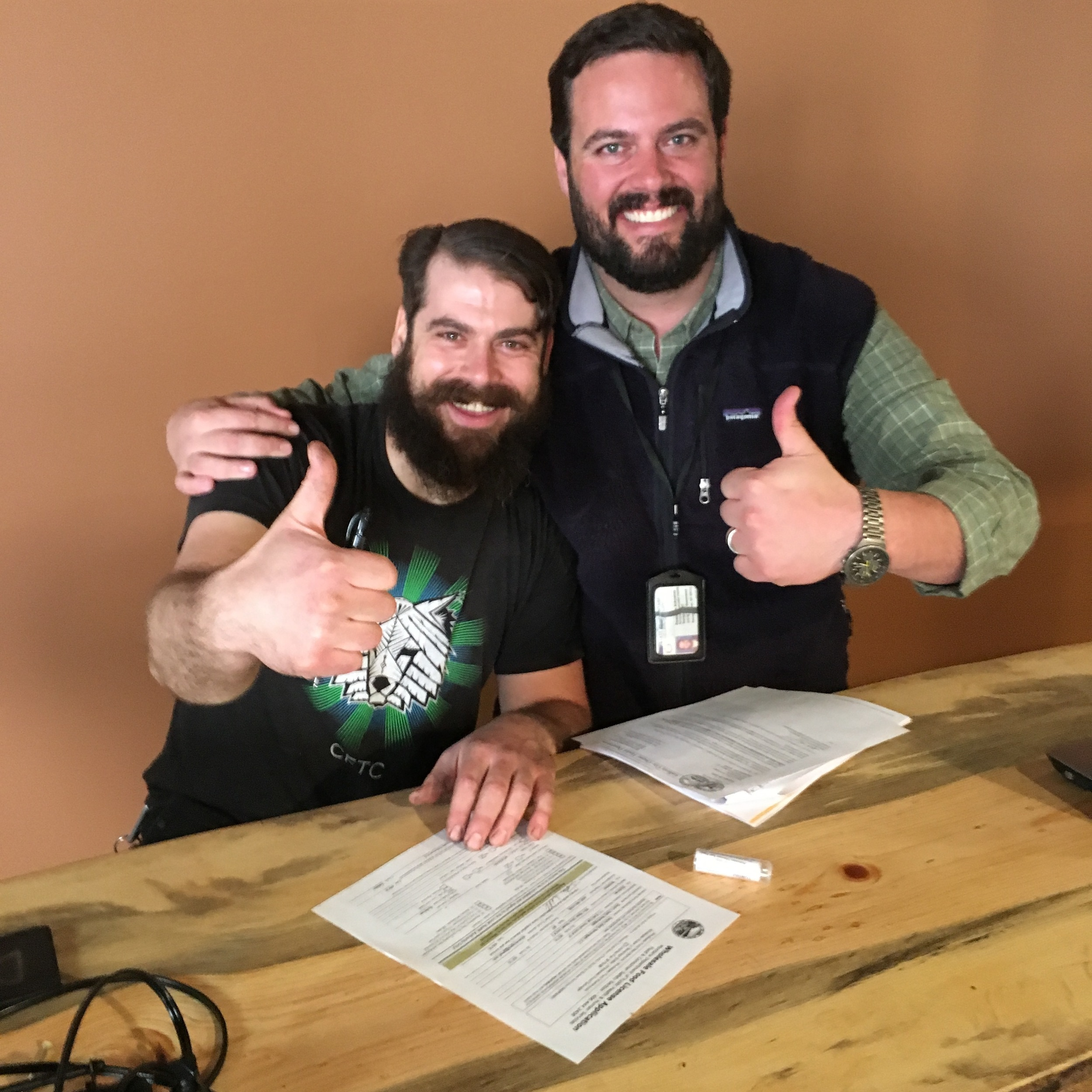 Dean (left) and Dustin Schreiner, signing final license applications!