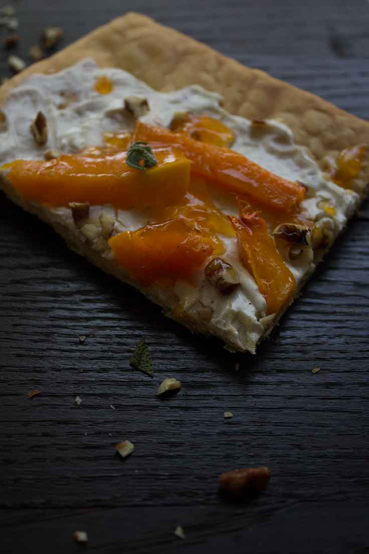 This rustic-looking roasted butternut squash tart is the perfect fall entertaining appetizer.