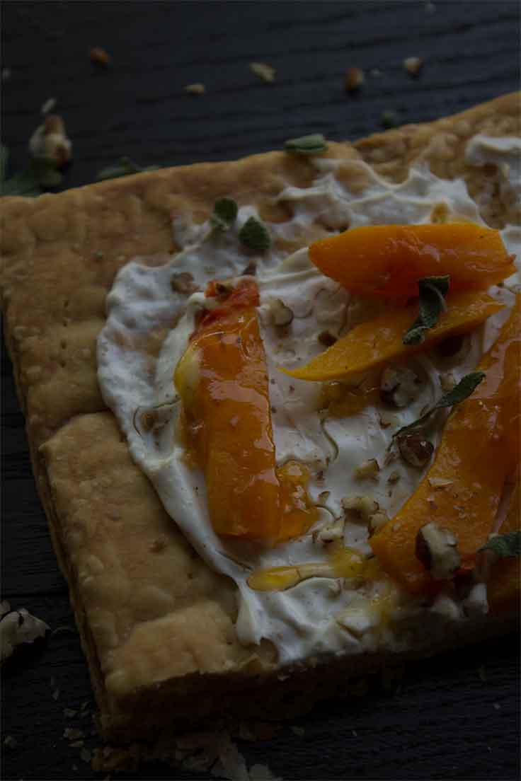 This rustic-looking roasted butternut squash tart is the perfect fall entertaining appetizer. Insolence & Wine