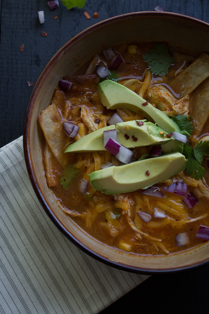 This easy chicken tortilla soup is cooked in the slow cooker and is perfect for cold fall nights. insolenceandwine.com