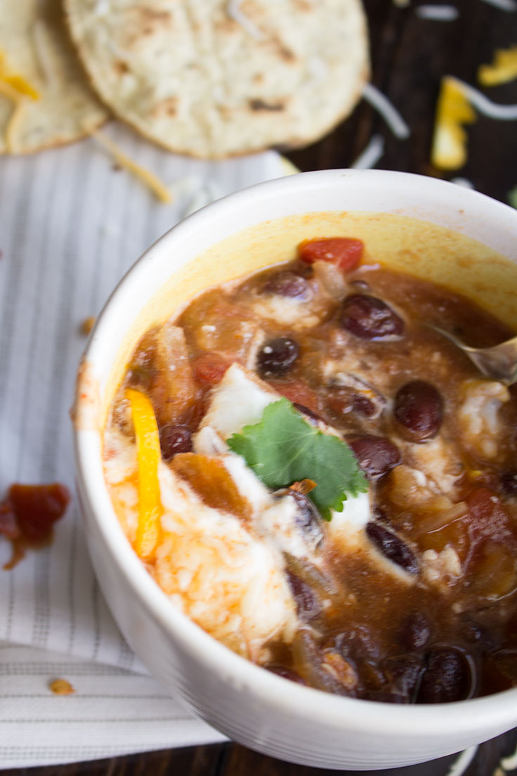 This vegetarian orange black bean chili is the perfect remedy for a cold winter night.