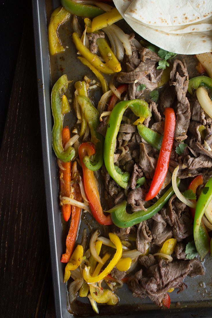 sheet-pan-fajitas-6.jpgThese one sheet pan beef fajitas are the perfect solution for busy weeknights. #onesheetpandinner