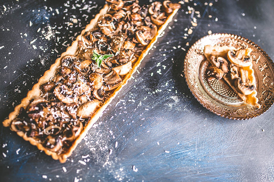 This mushroom tart is easily and quickly made with store-bought pastry dough. Ideal for parties paired with an earthy red wine. | insolenceandwine.com