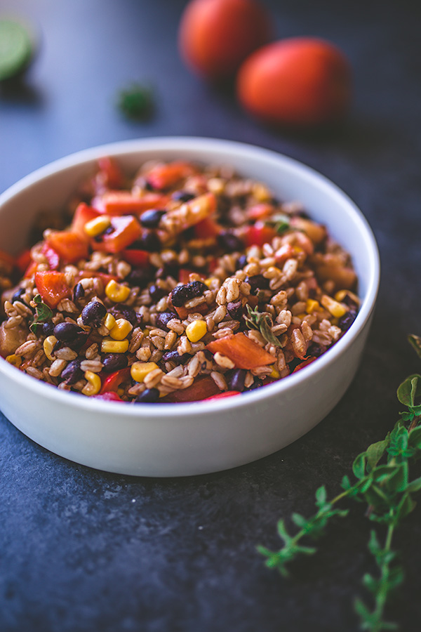 Farro and black bean salad is filled with fresh summer produce and delicious spicy flavors. | insolenceandwine.com