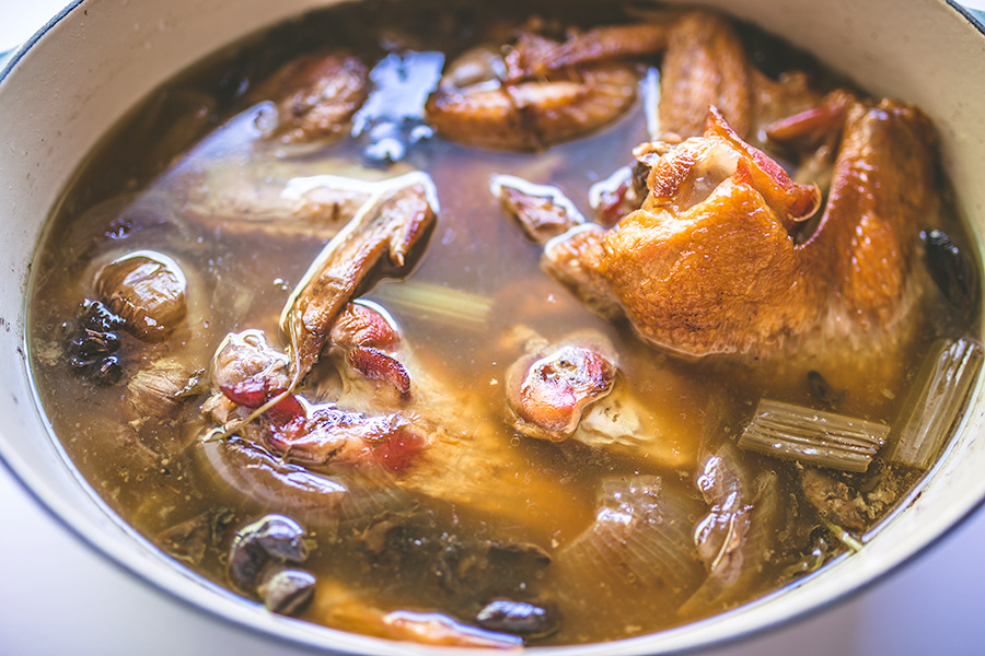 Easy and delicious make ahead turkey stock freezes nicely so it's ready to be used in any Thanksgiving recipes calling for turkey stock. | insolenceandwine.com