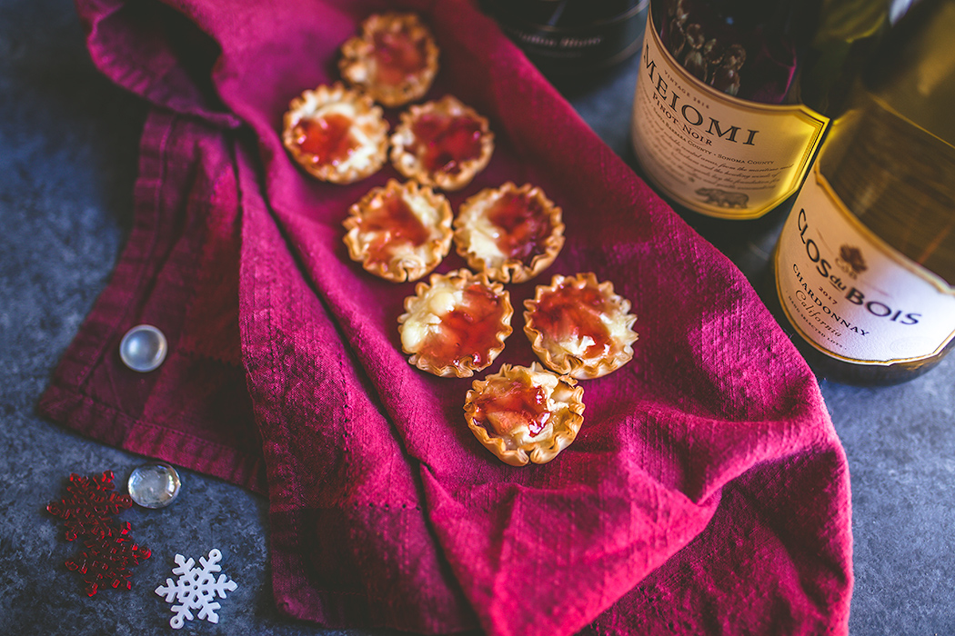 Festive and easy baked brie bites make an ideal appetizer. | insolenceandwine.com