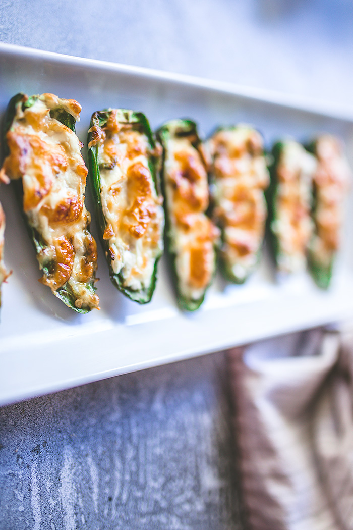 Extra cheesy, super spicy air fryer jalapeño poppers is just what your Super Bowl party needs this year.