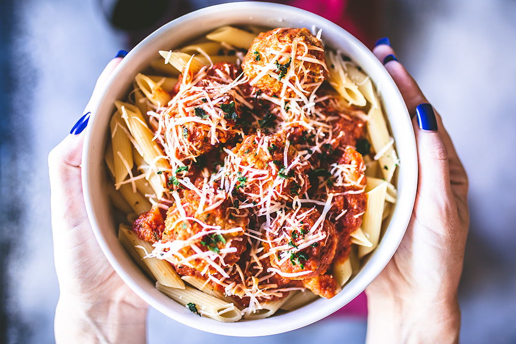 A healthier alternative to traditional beef meatballs, this pasta and spicy chicken meatballs are served with a subtle, but spicy homemade tomato sauce.
