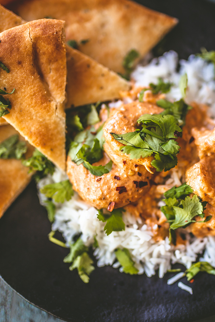 Traditionally made with chicken, Indian butter shrimp is  moderately spicy  and best served over  basmati rice with naan. Pair it with an acidic Central Coast wine.