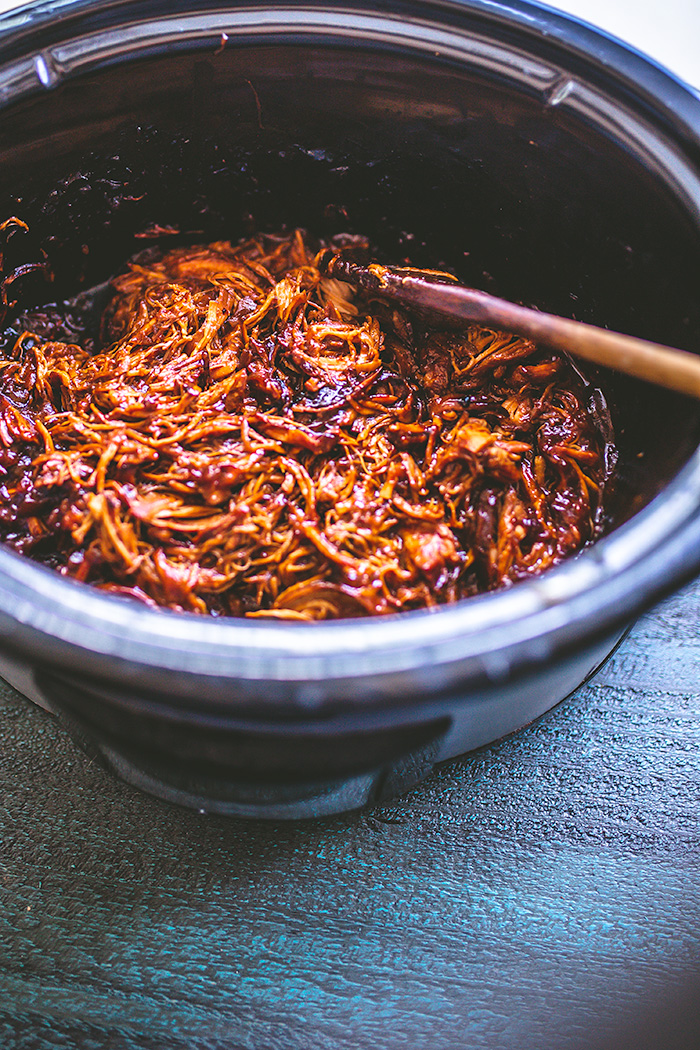 Slow cooked chicken is simmered with pineapple chunks and zesty BBQ sauce.