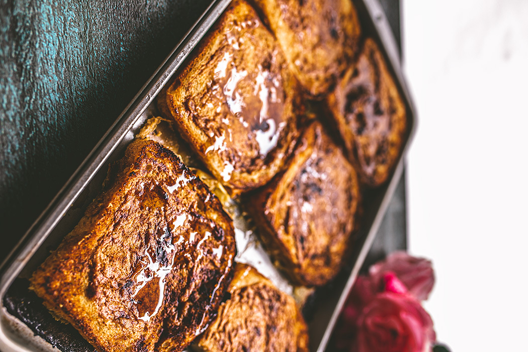 Thick slices of country white bread are quickly soaked in the batter, then covered with a beautiful mango glaze before baking.