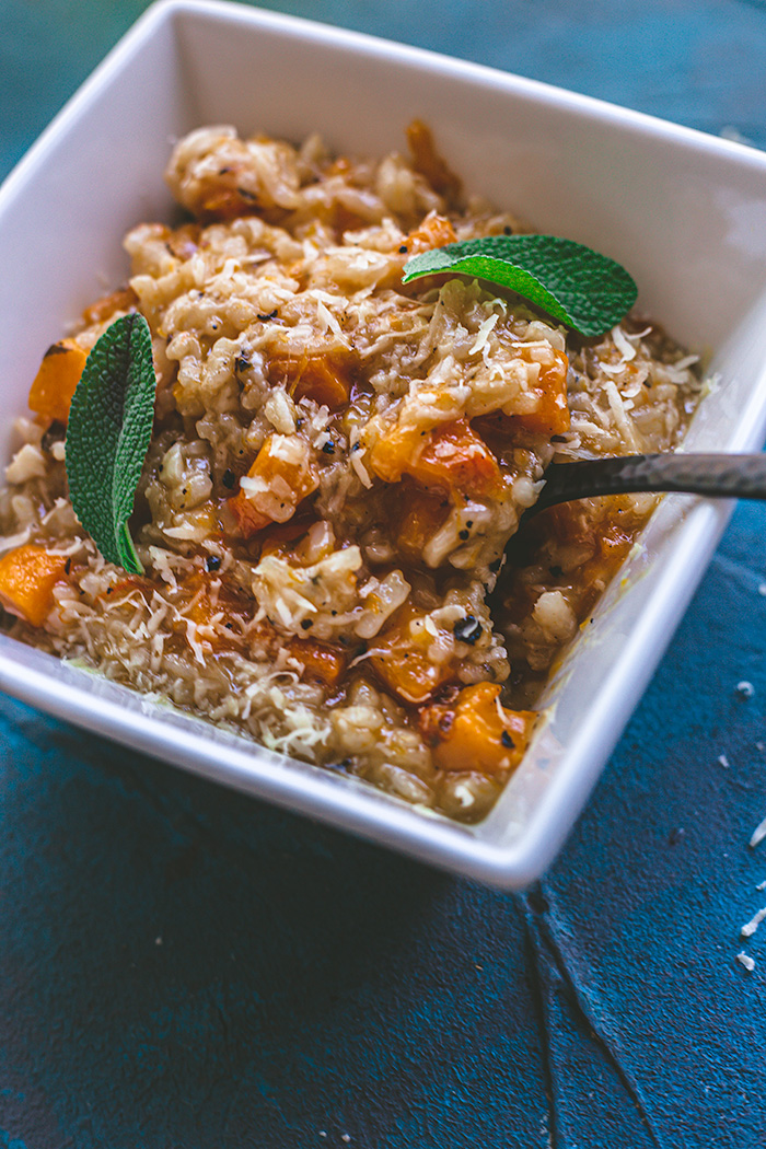 Roasted butternut squash is added to a creamy thyme and viognier instant pot risotto for a comforting fall dinner.