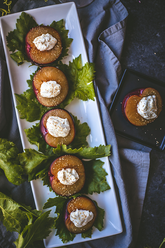 Maple roasted plums with goat cheese can be served as an appetizer or dessert.