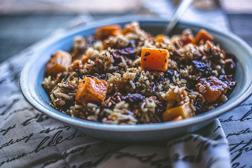Meet your new favorite Thanksgiving side dish: wild rice with a hearty serving of roasted squash and dried apricots and cherries.