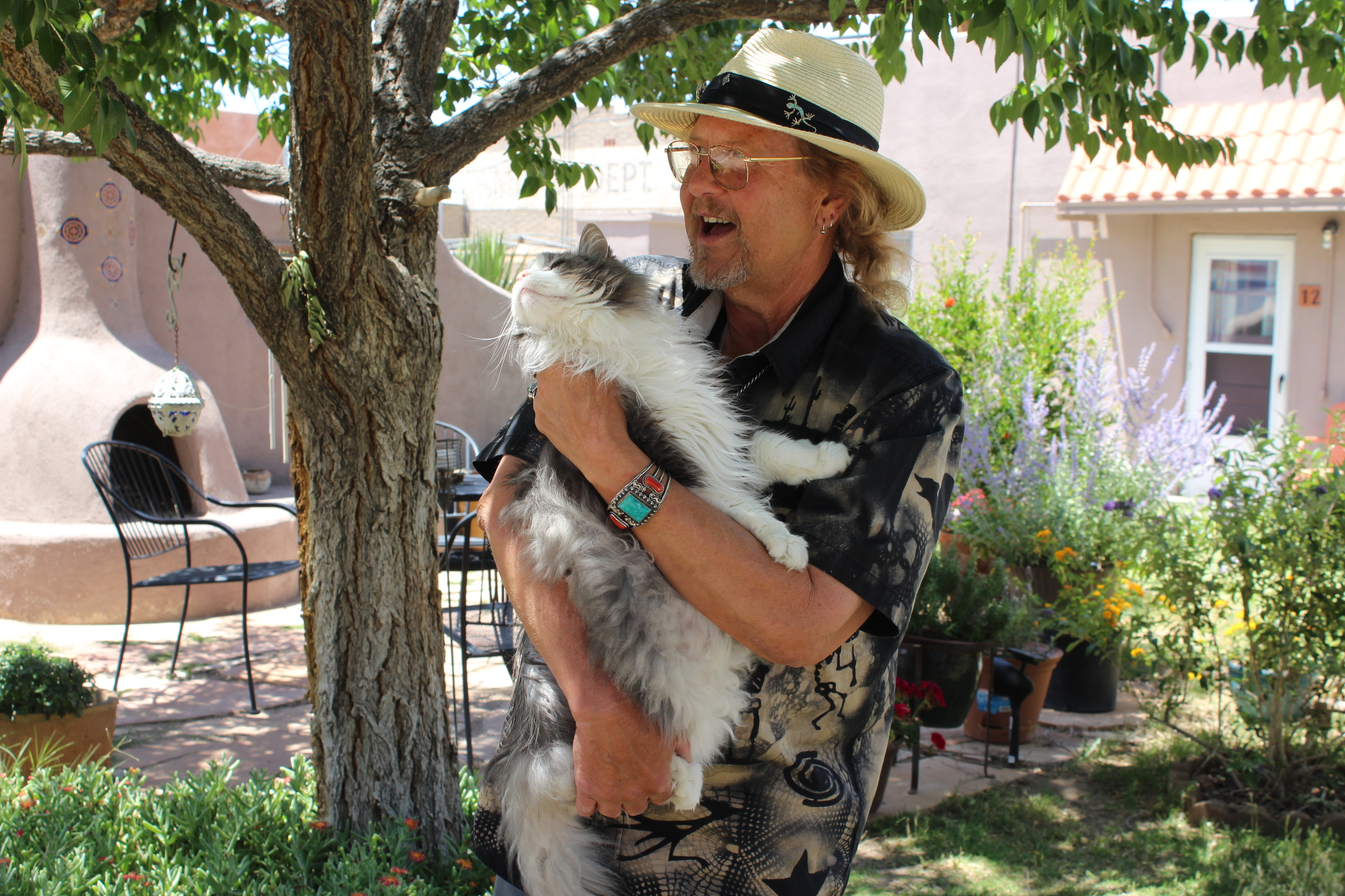 This is Christopher's cat Big Daddy. He found him in the desert and the two have been inseparable since. One time, while they were traveling around in Christopher's RV, Big Daddy jumped into another truck and started checking out the pedals. The truck-owner, who happened to be a fellow fortune teller, said that Big Daddy used to be a trucker in another lifetime. Christopher says this explains how content Big Daddy is in a car. They've traveled the country together.