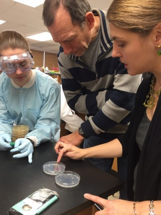 NICHOLE BRODERICK  (RIGHT) CONSULTS WITH DAVID KNECHT (CENTER) ON DIFFERENT POTENTIAL ASSAYS FOR JENNA DICKINSON'S (LEFT) WORK. (KIM KRIEGER/UCONN PHOTO)