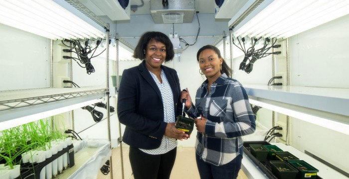 BETSY ROBERTS  (LEFT) – ASSISTANT PROFESSOR OF BIOLOGY – WITH STUDENT LAETICIA IBOKI. IBOKI AND A FORMER CLASSMATE WILL PRESENT THEIR RESEARCH ON A NEW ANTIBIOTIC THIS SPRING ON CAPITOL HILL.