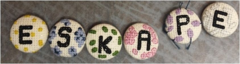 """CROSS-STITCHED """"ESKAPE"""" KEYCHAINS TO RAISE AWARENESS ABOUT ANTIBIOTIC-RESISTANT PATHOGENS. PHOTO CREDIT: ASHLEY CAMPBELL."""
