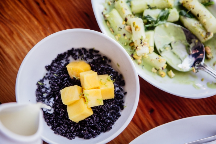 Chef Mike Whisenhunt's hot puffed rice served with sweet, warm coconut milk and fresh mango.