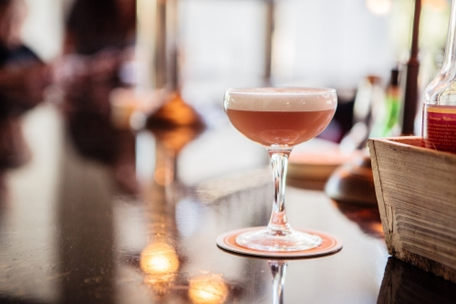 "The ""Italian Panache"" - a delightful combination of Carpano dry vermouth, lime, grenadine, and egg whites."