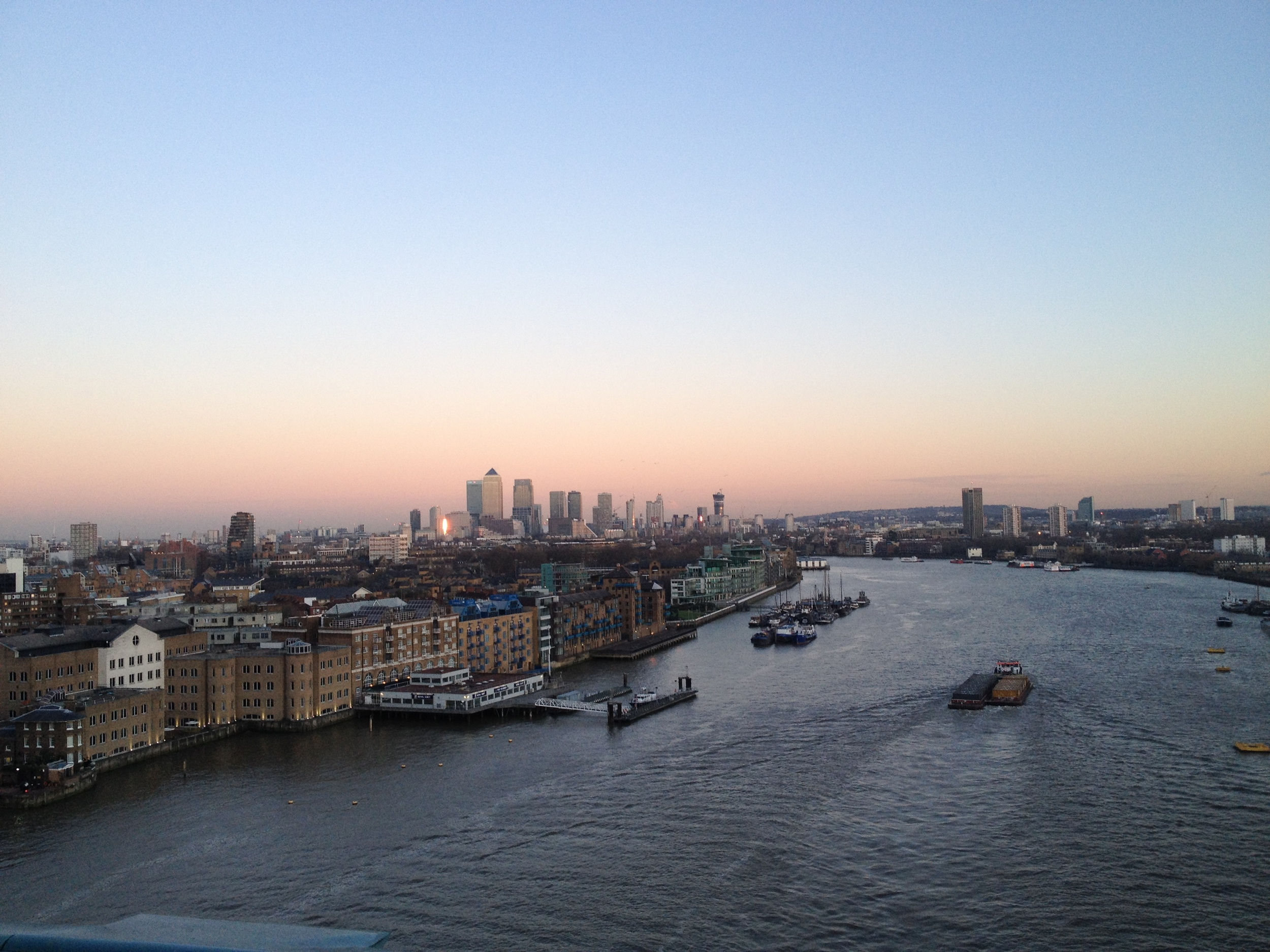 A view from Tower Bridge looking out across the Thames towards the financial hub of London