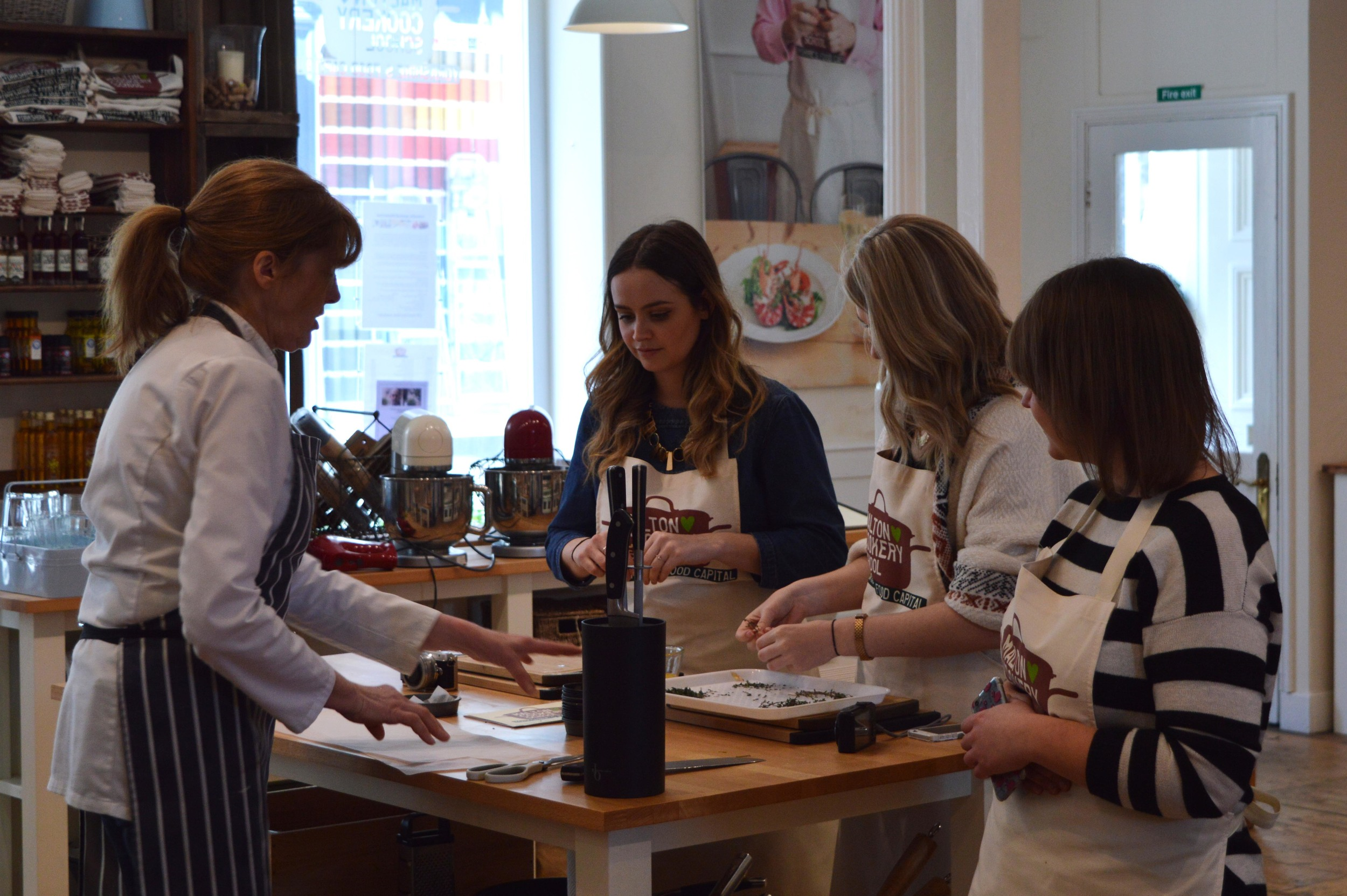 Gilly shows some of the fellow guests how to cook with fine Yorkshire produce.