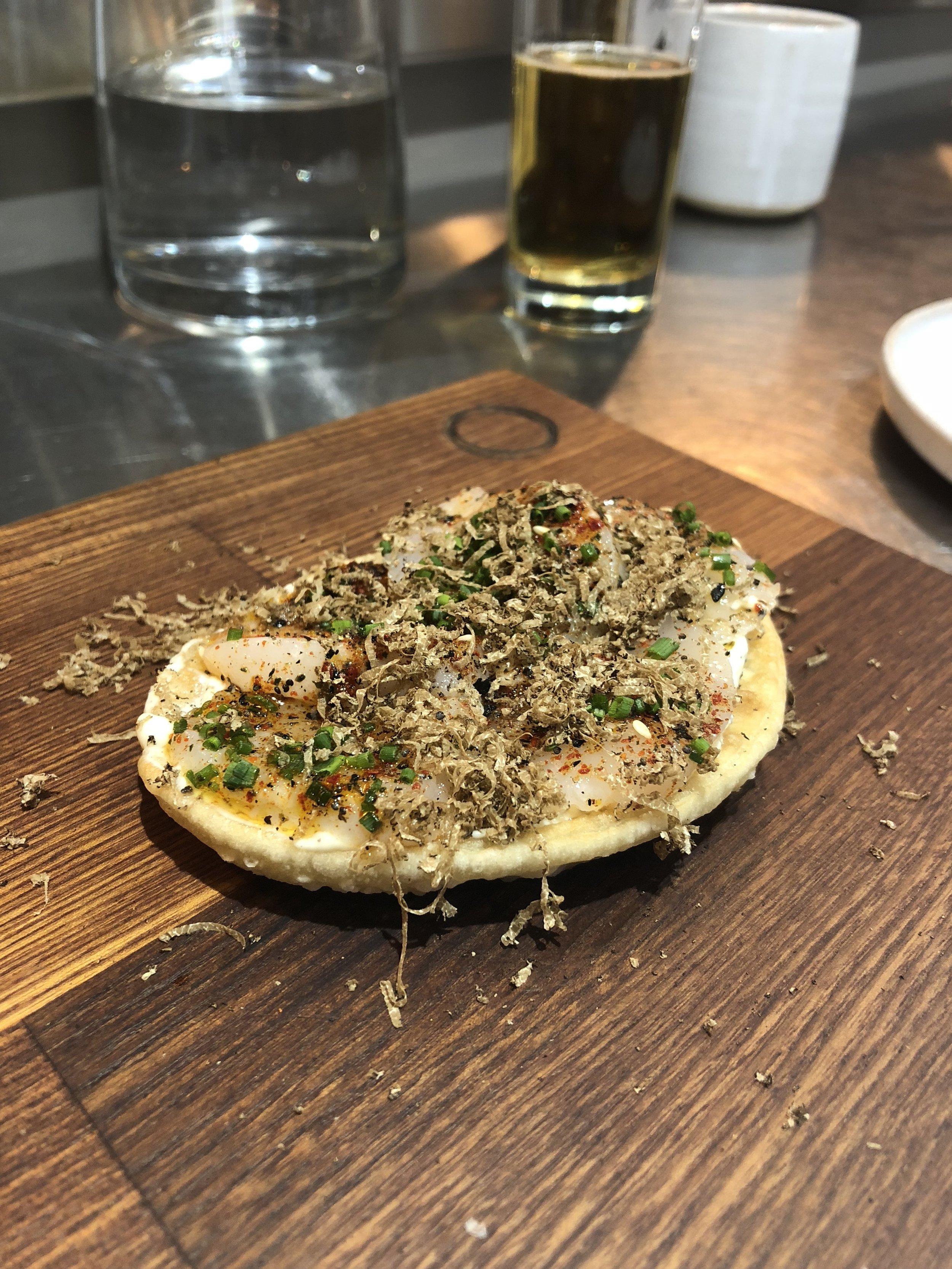 hand dived scallop sashimi 'pizza' - spring truffle & togarashi spice